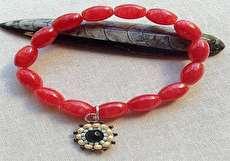 تصویر از ساخت دستبند با مهره و کش